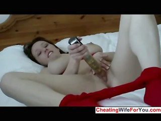 doxy with large whoppers plays with a large toy