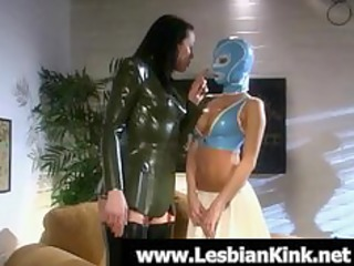 lesbian babes in rubber raiment flogging booties
