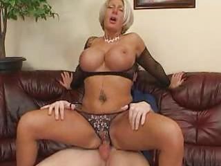 breasty aged blond in black fishnet brassiere