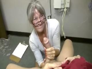 older doctor on her knees stroking off male