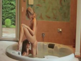 nice-looking babes in a tub have a passionate