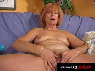redheaded grannny plays with her sex-toy