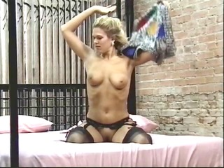 sexy juvenile golden-haired bends over and shows