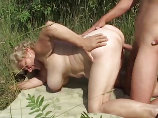 german granny outdoor with young guy by troc