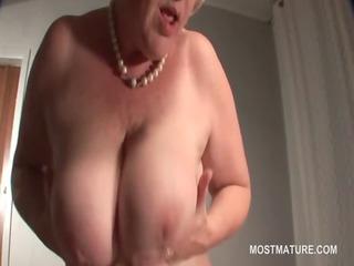 aged blondie masturbates with a cucumber