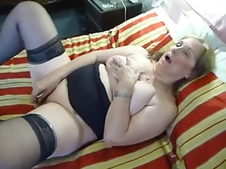 aged bulky dildoing on couch