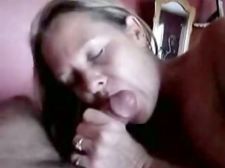 mature lady gives an experienced blowjob