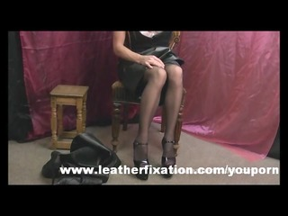 ribald redhead put on leather petticoat and boots