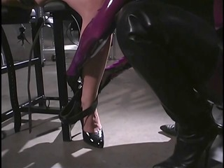 latex female-dom punishes captured dark brown