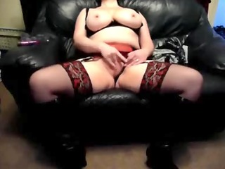 slutty wife on a leather ottoman at home